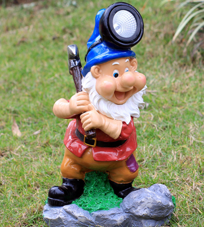 Gnome with hammer and headlight